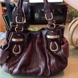 B.Makowsky used burgundy leather purse